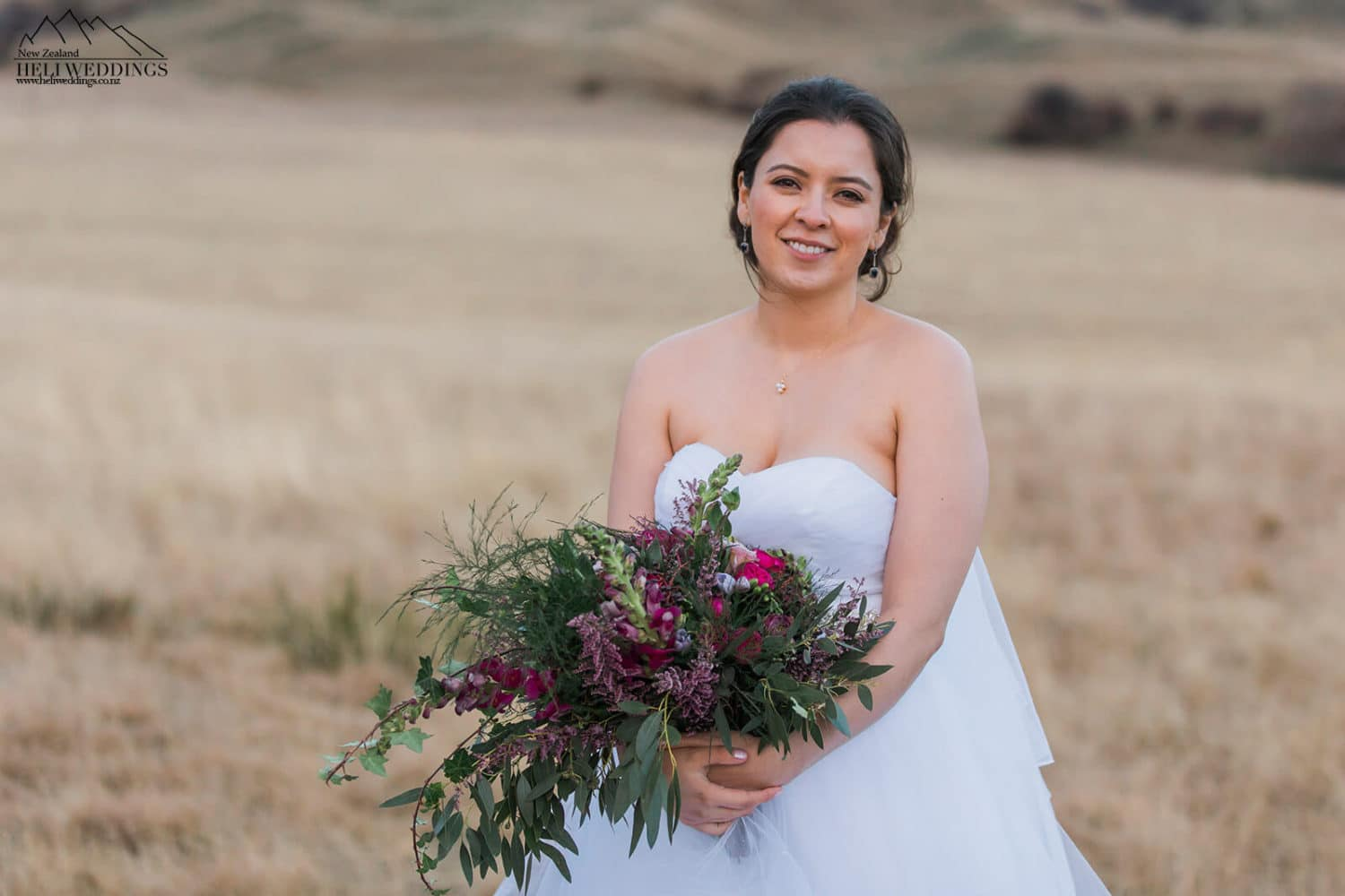 Bride with wild flower bouquet