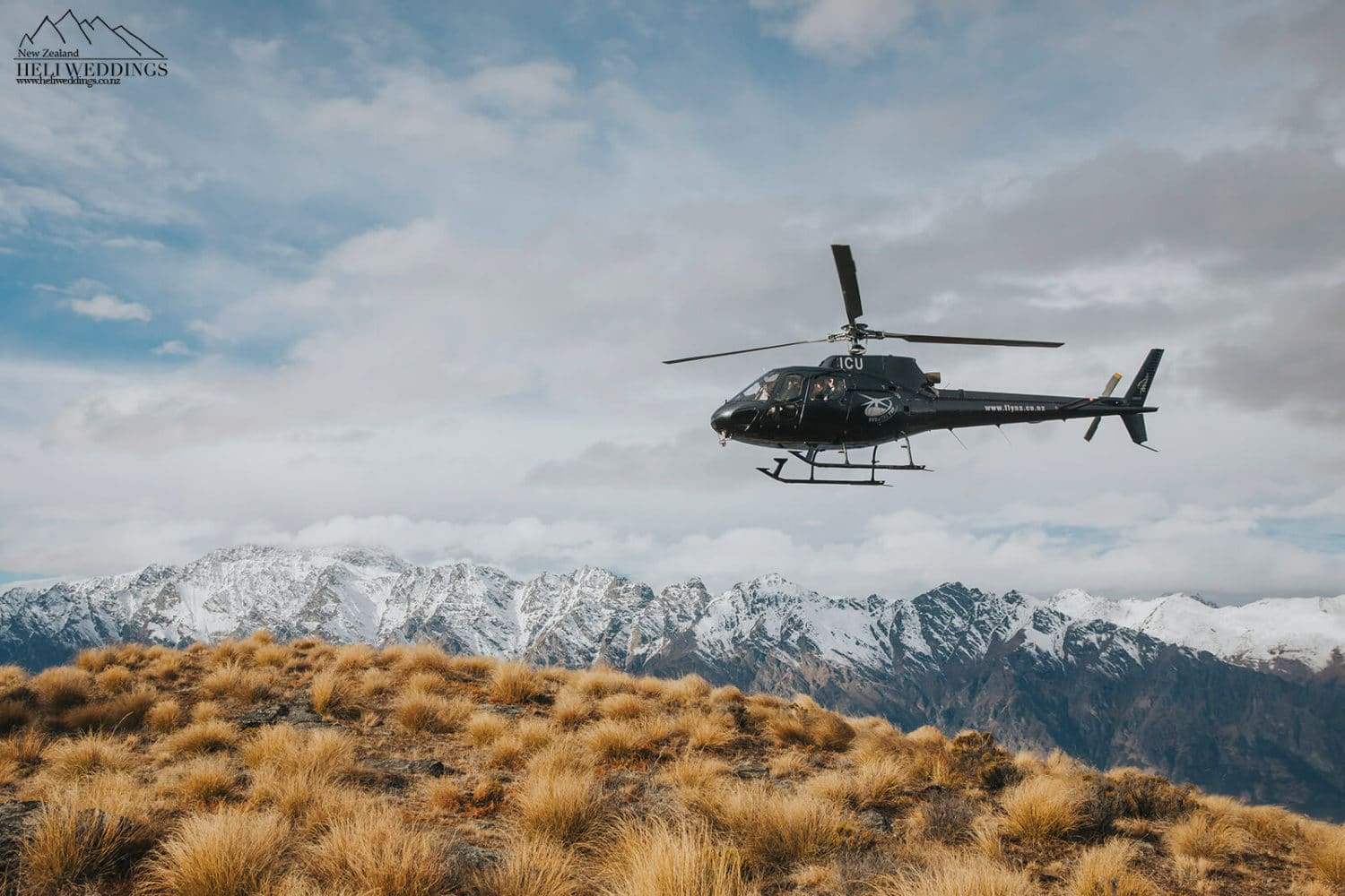 Helicopter arriving to mountain wedding with guests