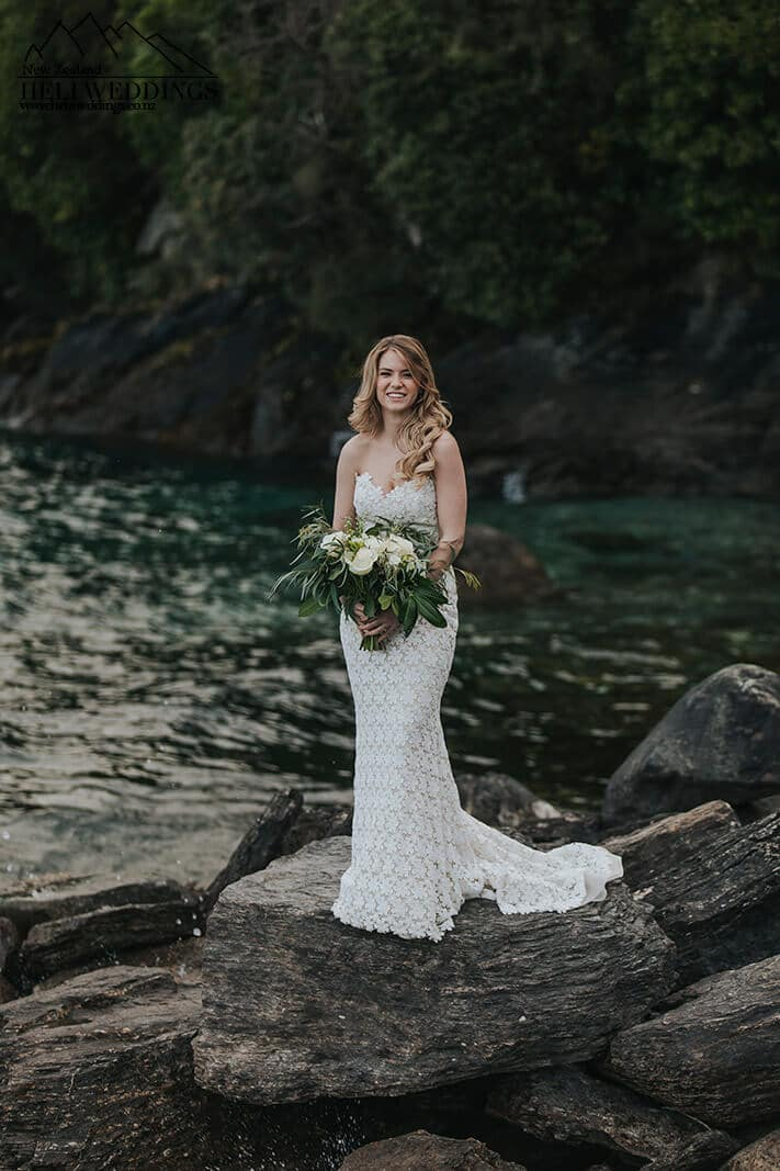 Bride by the lake in New Zealand