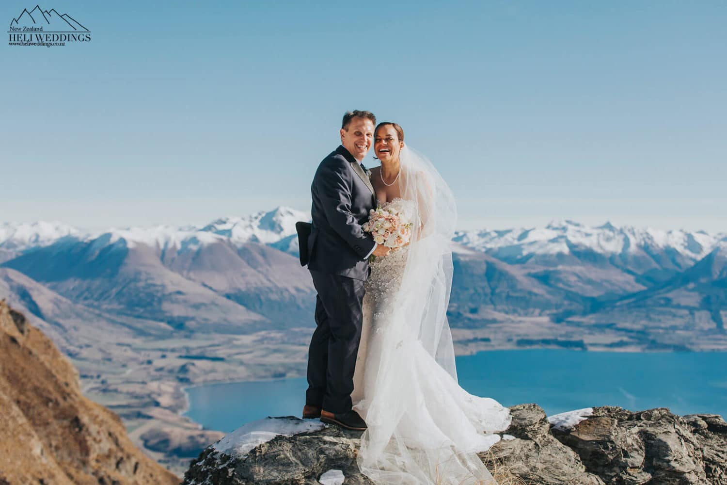 Bride and groom on the mountain in Queenstown