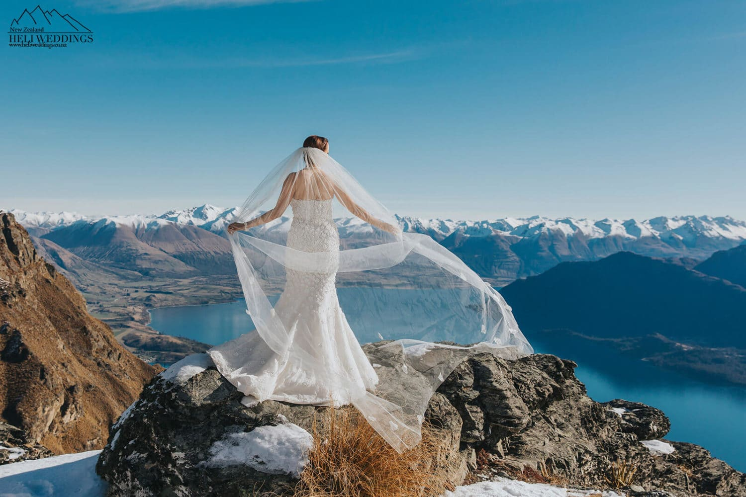 Bride on snowy mountain in Queenstown