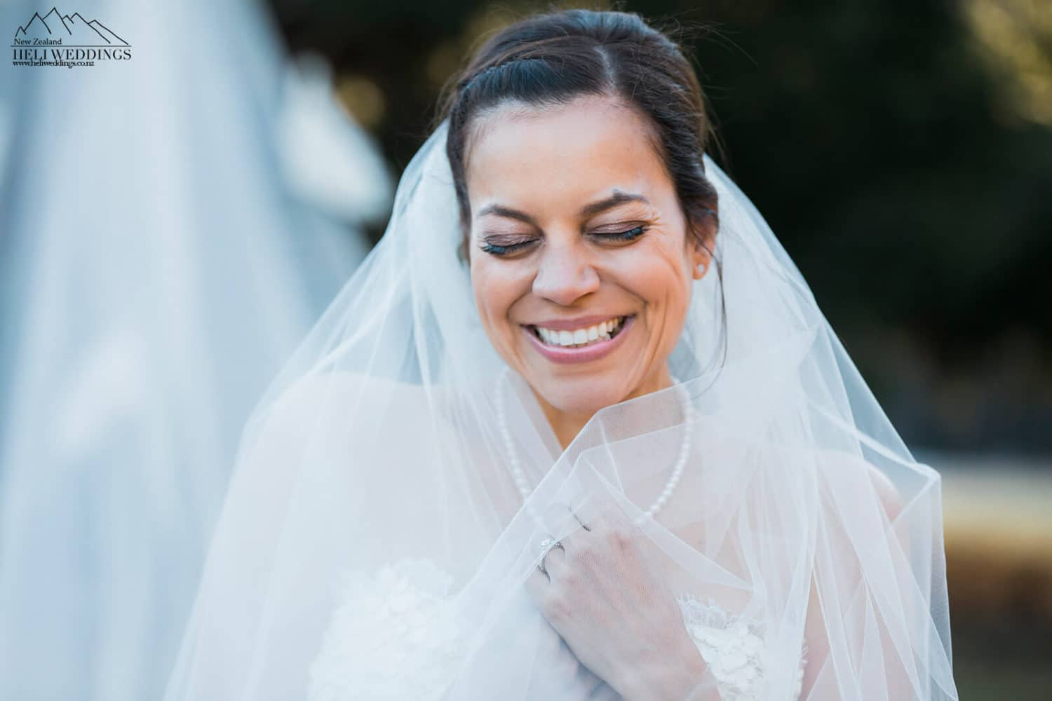 Bride with veil in at Queenstown wedding