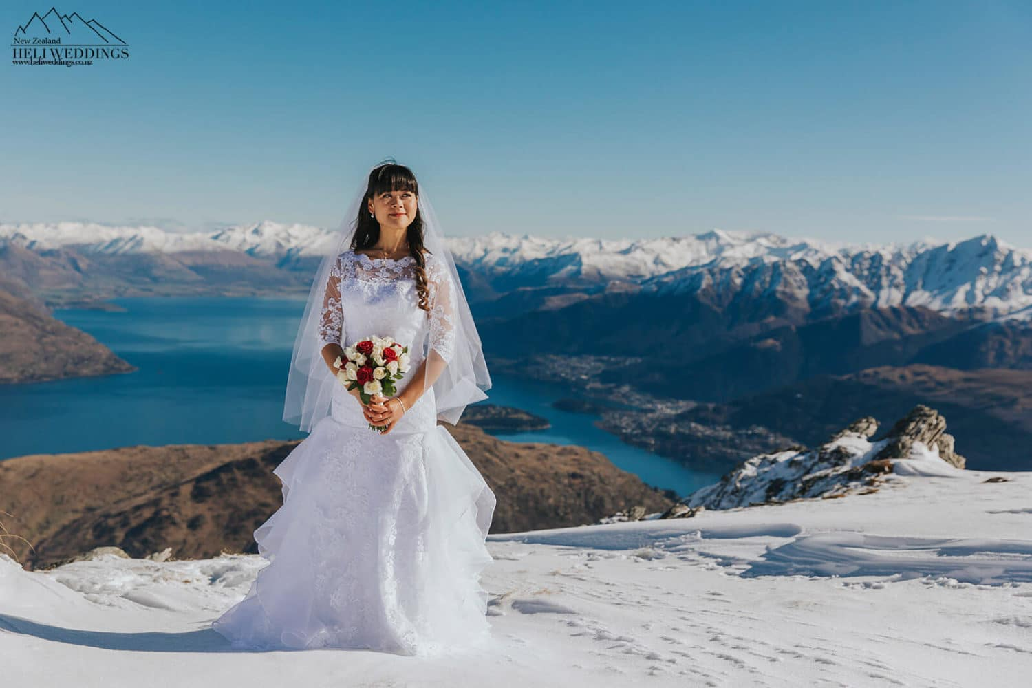 Wedding photos on The Remarkables Queenstown , Snowy winter wedidng