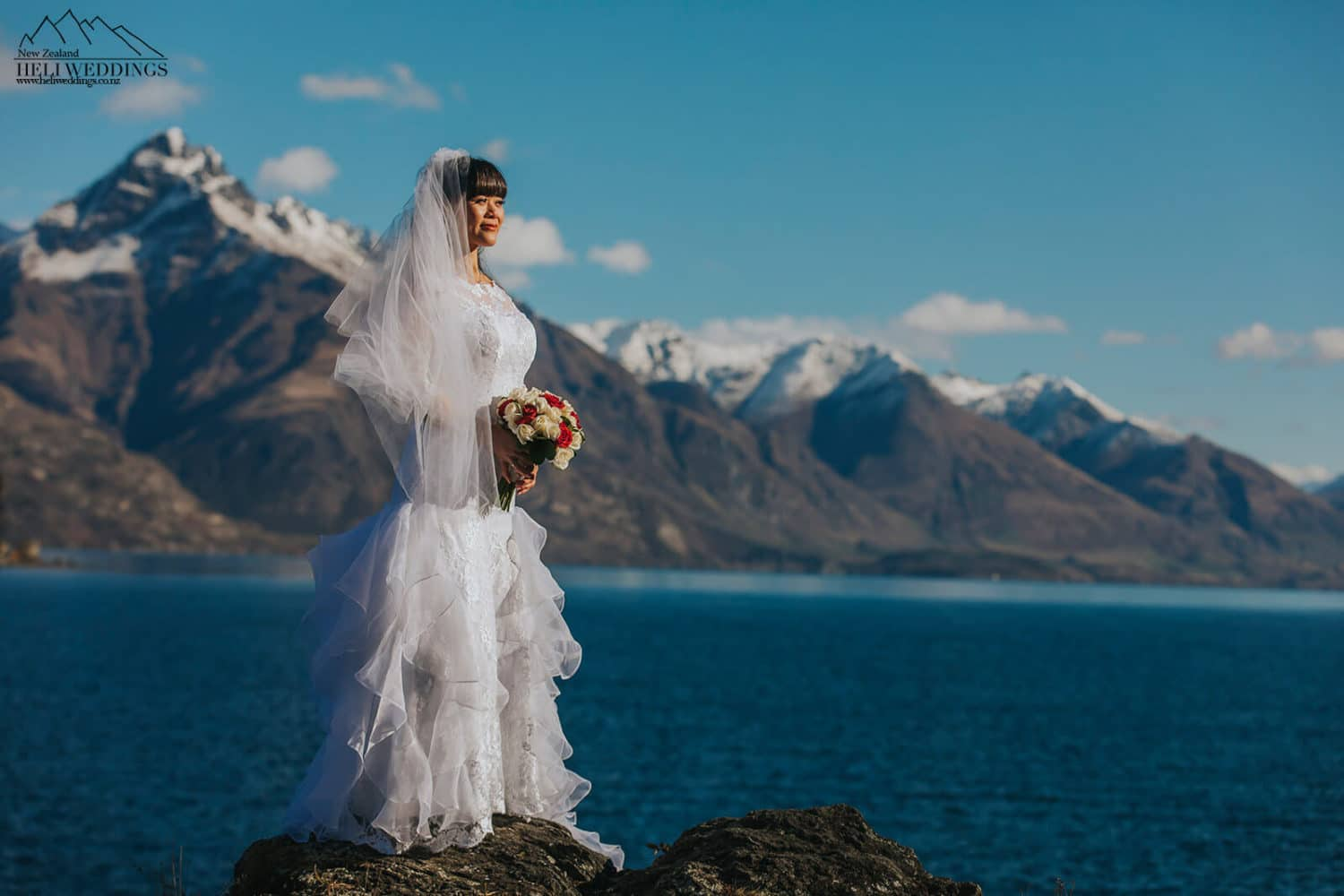 Bride with lake and snowy mountains in Queenstown