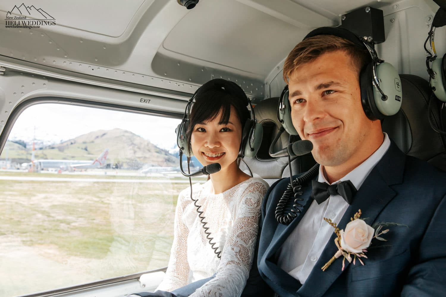 Bride & groom in helicopter
