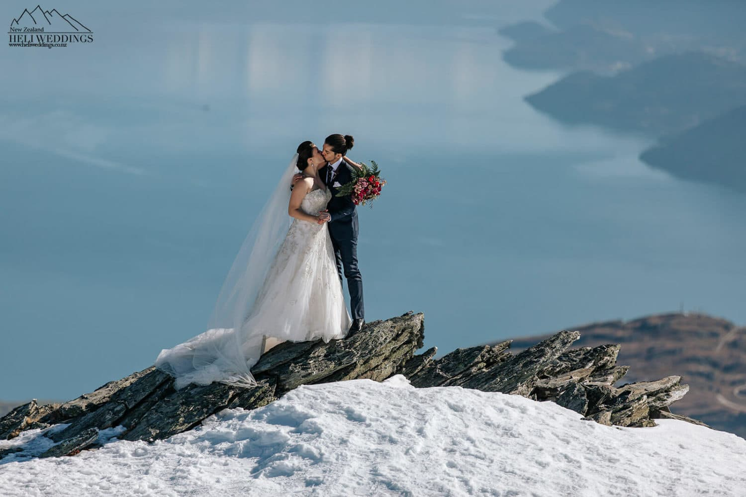Bride and groom in the snow on the Remarkables