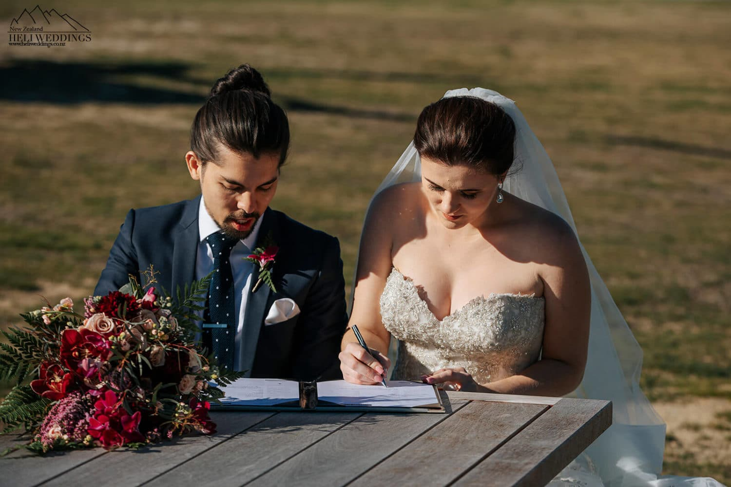 Signing the wedding license in Queenstown