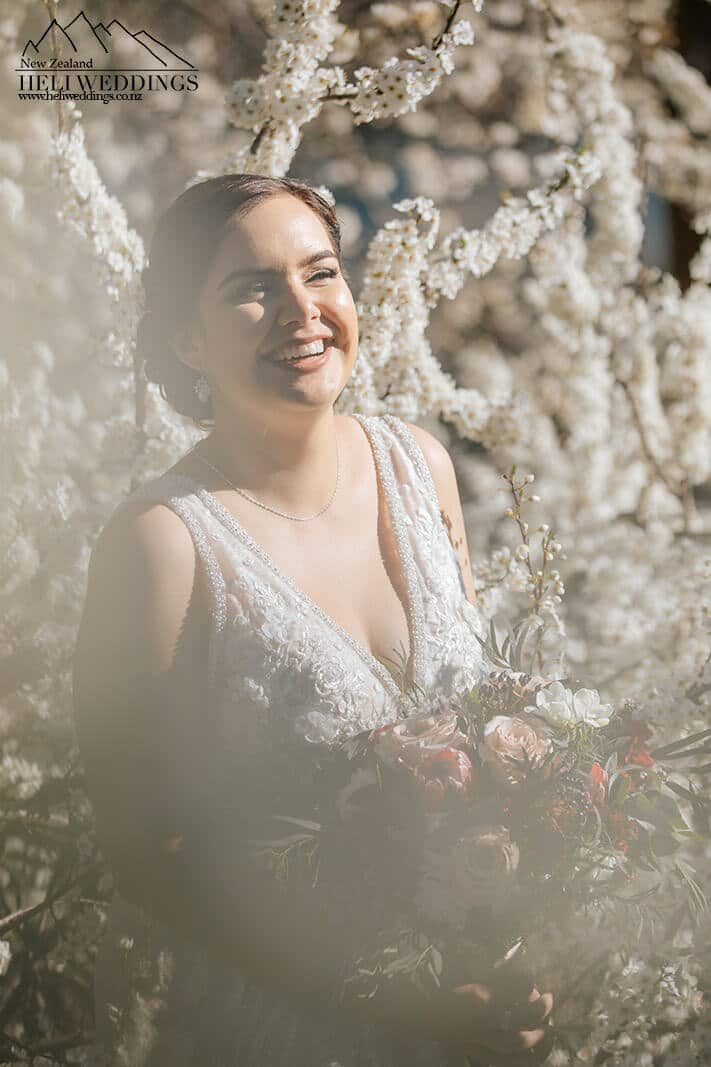 Bride among the blossoms in Queenstown