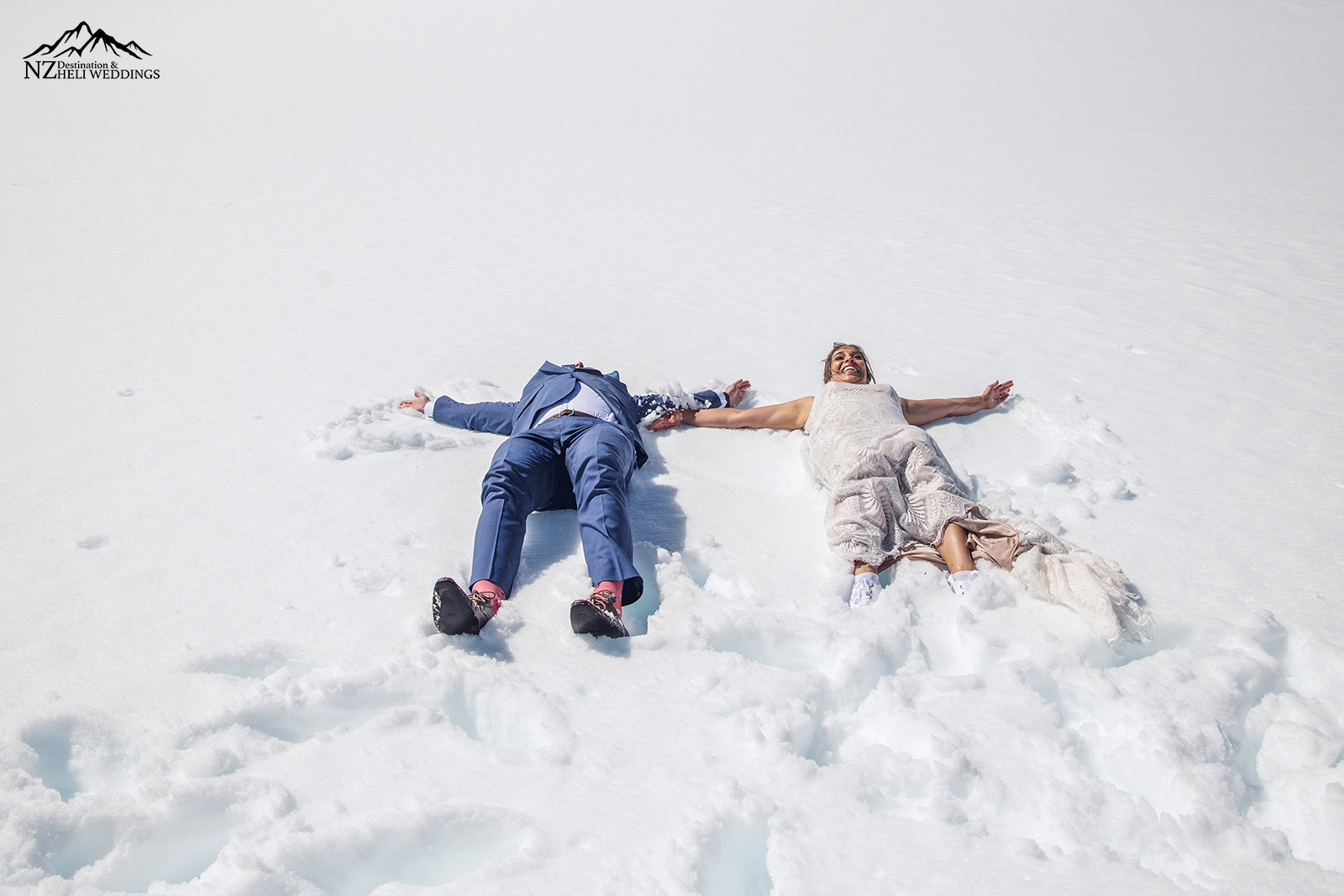 Making snow angels in your wedding dress