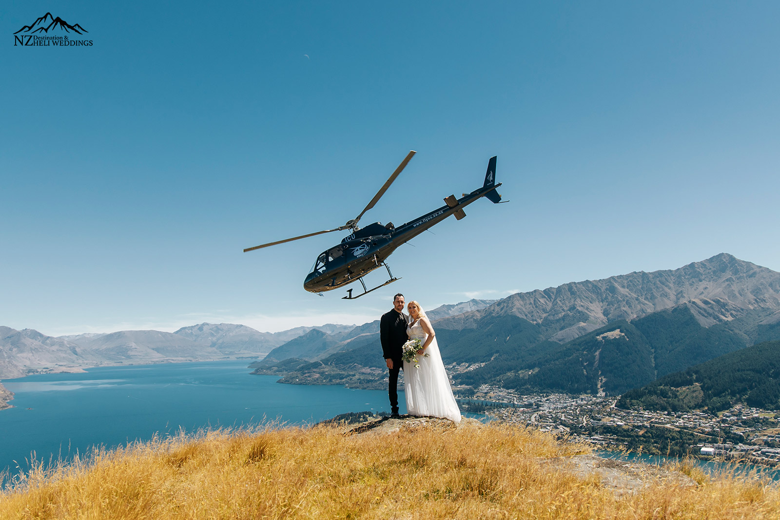 Queenstown intimate family wedding on deer park heights with helicopter taking off